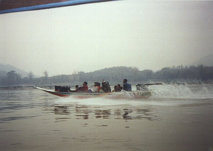 A passing fast boat in Laos